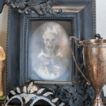 Halloween mantel scary photograph in a black frame