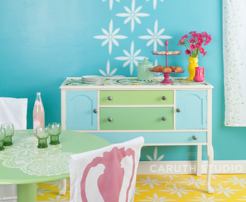 Stenciled dining room in green, blue and yellow