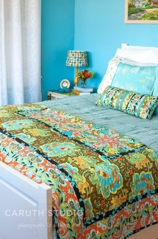 Bed with floral quilt