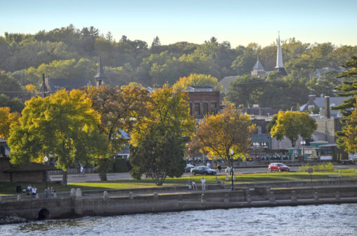 view overlooking stillwater Minnesota with the river in the foreground, and the town in the background dotted with autumn trees