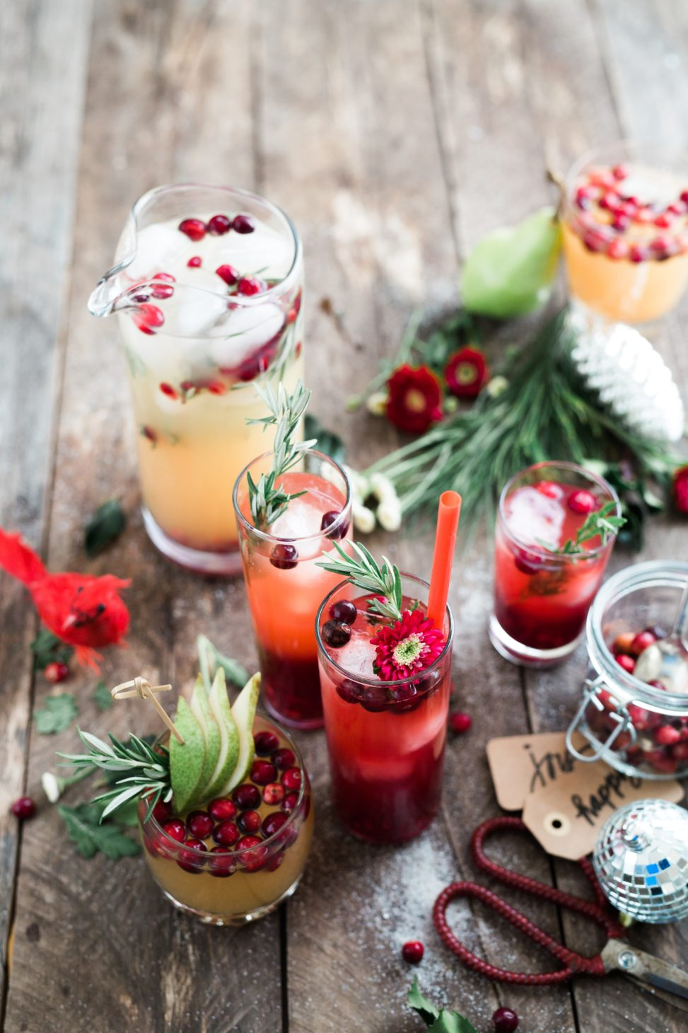 assorted holiday cocktail drinks in fancy drinking glasses