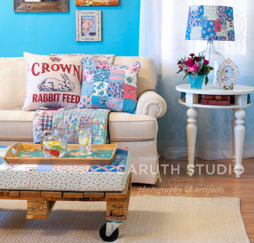 vintage floral patchwork decorations in a blue and cream livingroom