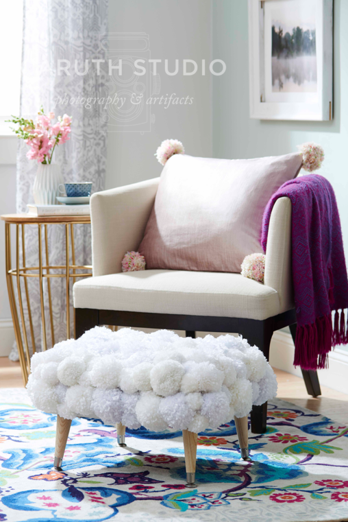 Chair with pom-pom ottoman