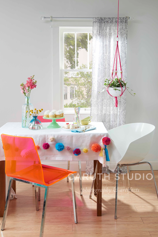 Dining table with pom-pom garland