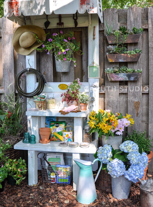 Door potting bench with tools and flowers
