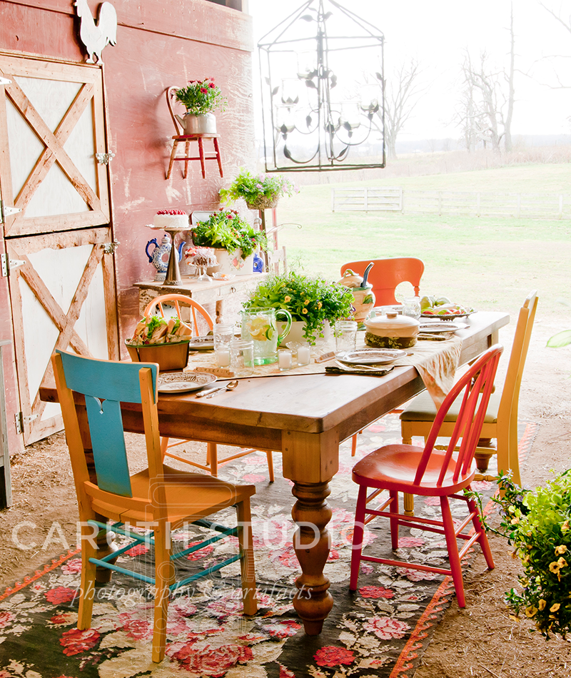 Table and chairs setup in a barn