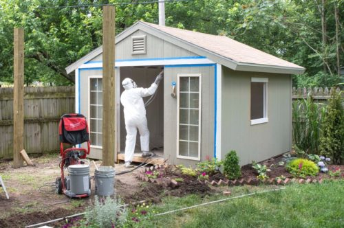 dad spray painting the shed