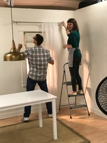 hanging curtains in the studio
