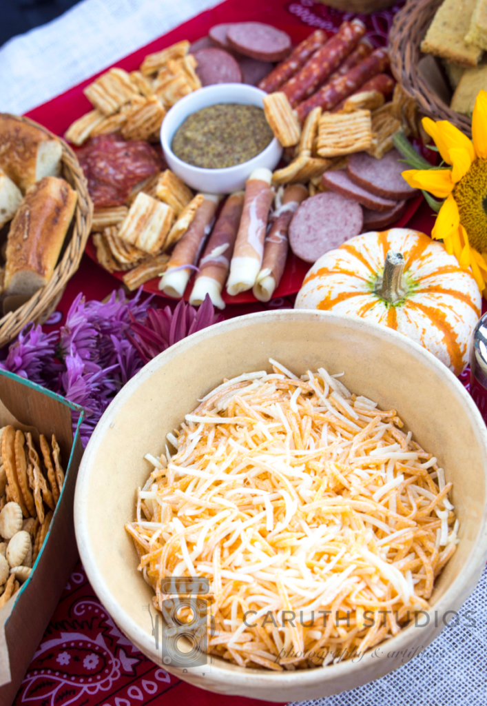 bowl of cheese topping next to meat and cheese try and pumpkins