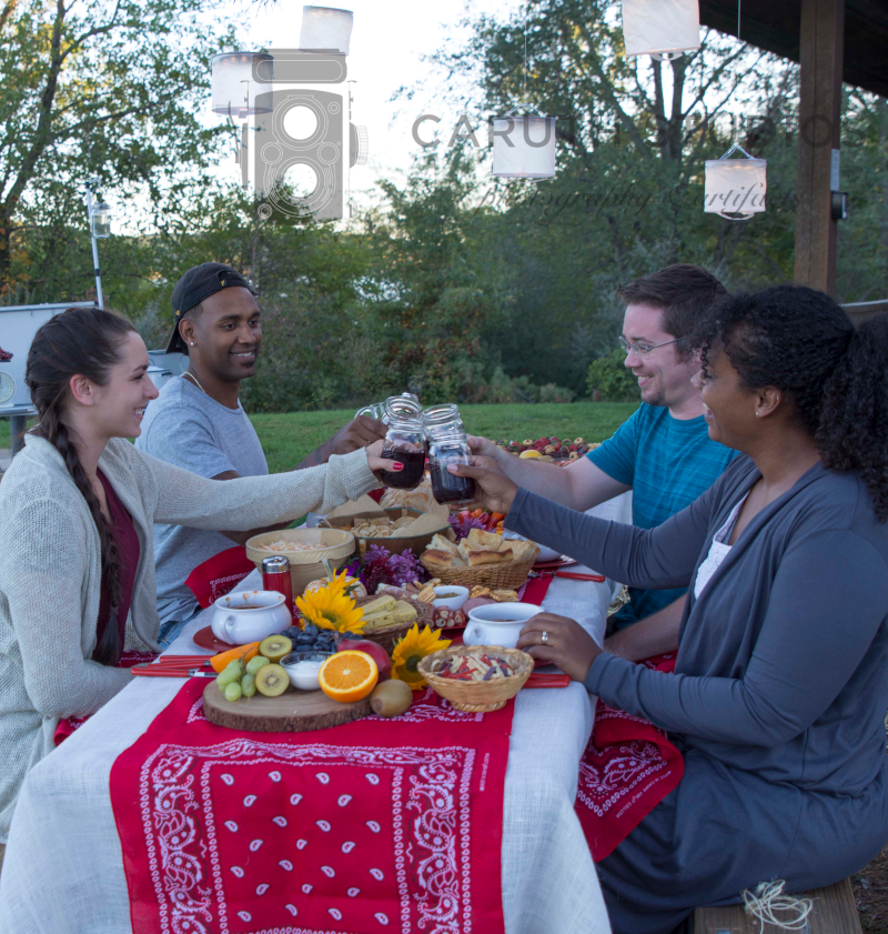 guests raising sangria to toast autumn chili party