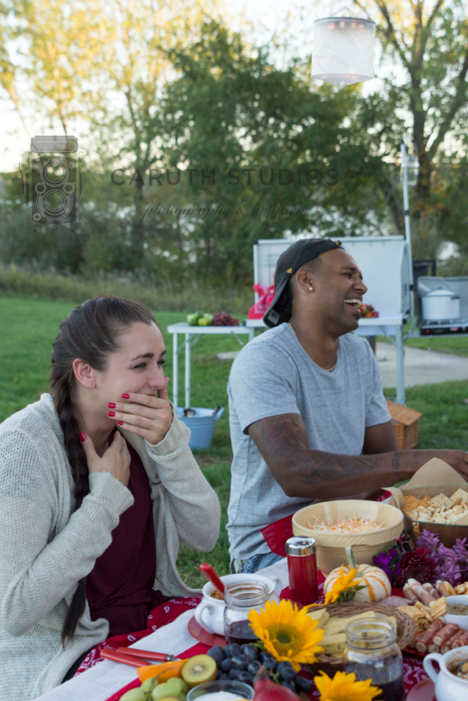 fall chili party guests having a good laugh