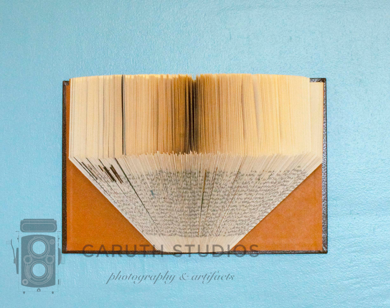 Folded book shelf hanging on the wall