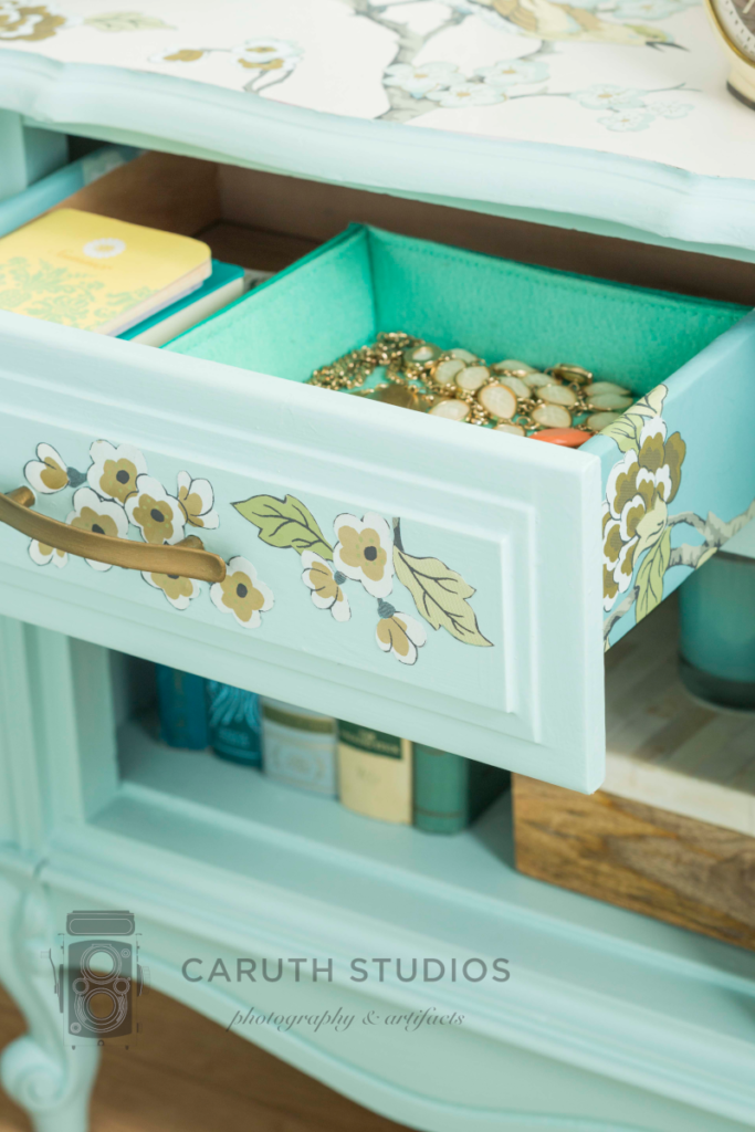 Nightstand drawer with wallpaper cutouts