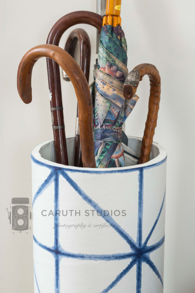 Wallpapered umbrella stand