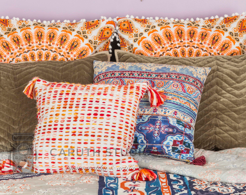 Colorful Bed pillows in orang blues and reds