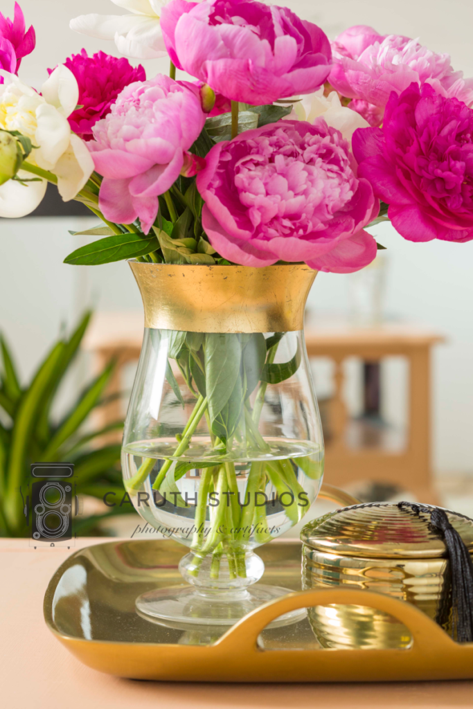 Gold rimmed vase with flowers