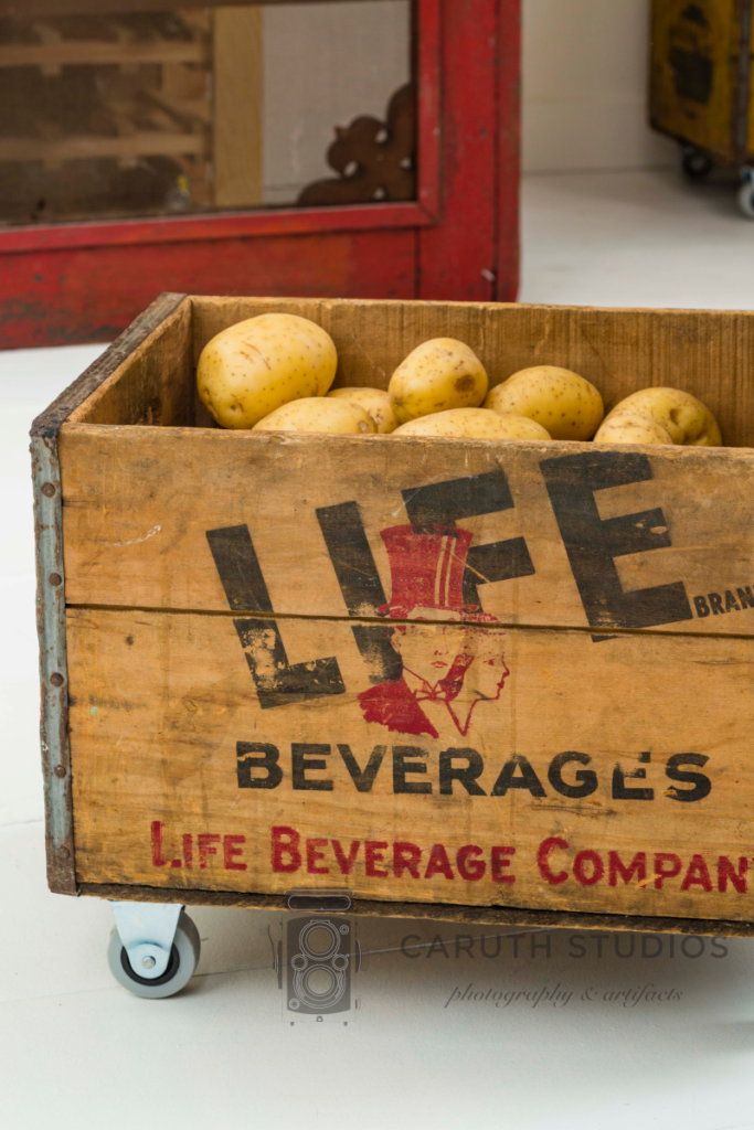 Vintage crate with potatoes