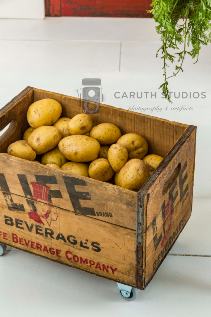 Wheeled crate of potatoes