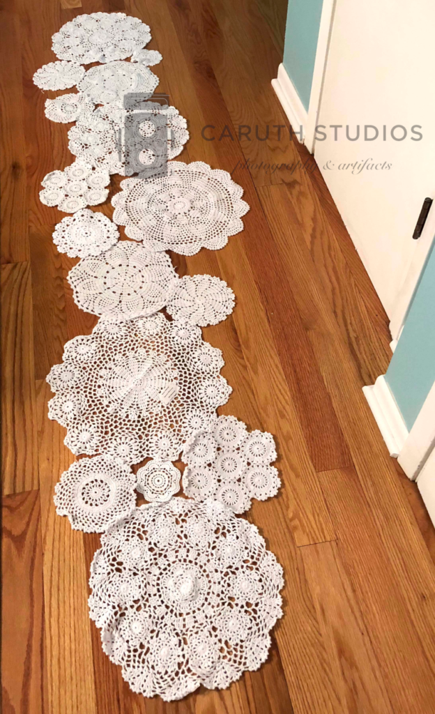 Doilies laid out for runner pattern