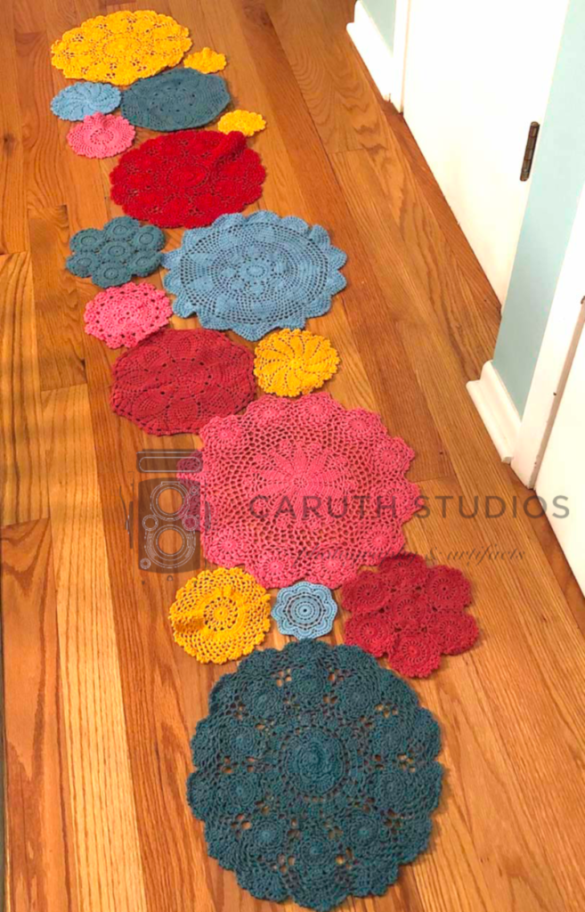 Dyed doilies laid out in pattern