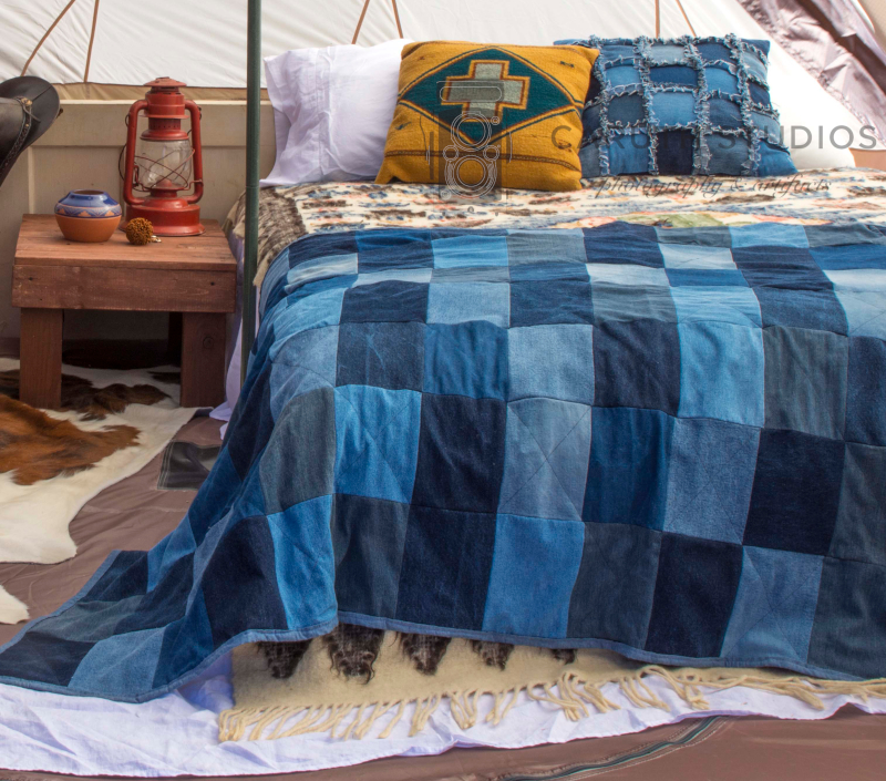 southwest style glamping bed, wooden door headboard and nightstand