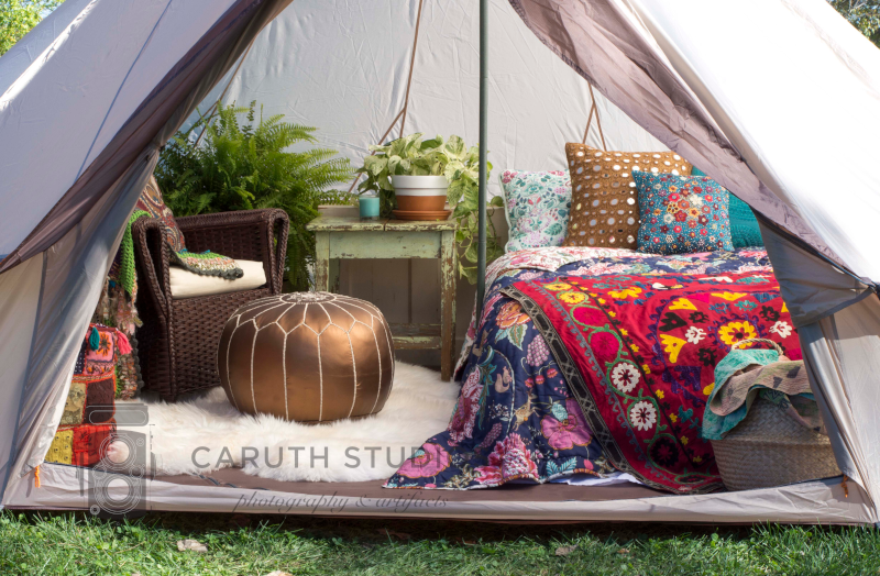 inviting boho bedroom in tipi with rugs and plants