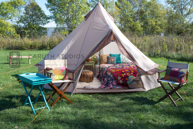 boho style tipi tent with canvas outdoor chairs