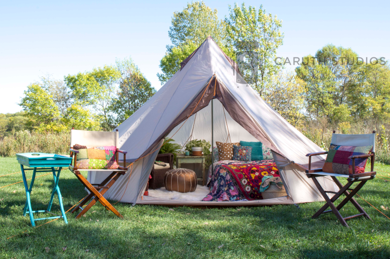 boho bedroom with rug, bed and nightstand in tipi tent