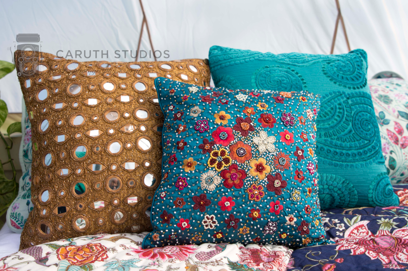 multicolored and textured throw pillows